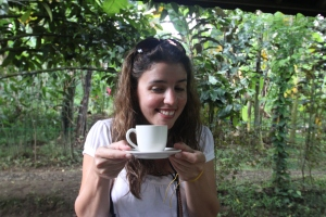 Michelle drinking the Luwak Coffee